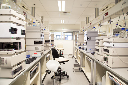 Research laboratory, no people, clean white, horizontal
