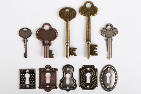 skeleton key: selection of keys and keyholes isolated on white