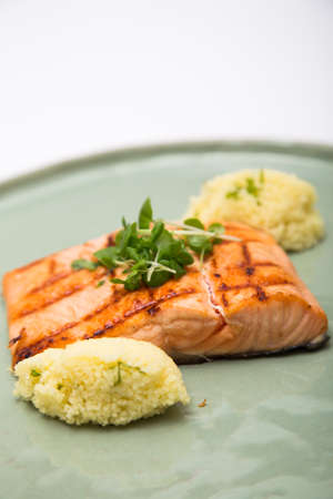 salmon fillet: Grilled salmon fillet on a plate shot against white background