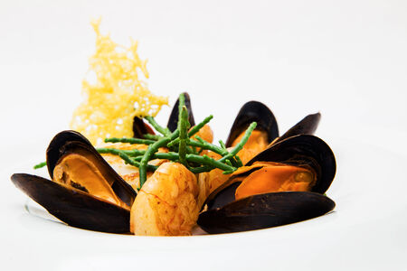 vertical format: Mussel and shrimp appetizer dish prepared at a restaurant, isolated on white, vertical format