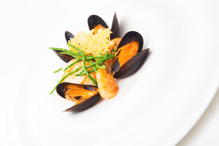 mollusc: Mollusc and mussels appetizer prepared at a restaurant, isolated on white, vertical format Stock Photo