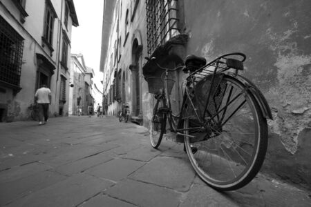 street life: Black and white shot of a European street life, bicycle in  the foreground
