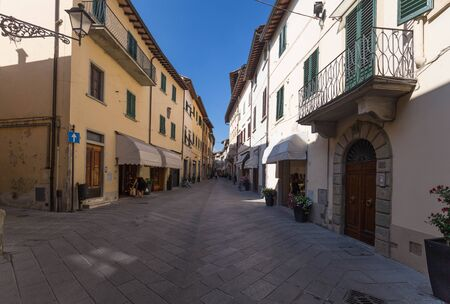 small town life: Street and alley in Lucca Italy