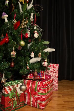 night before christmas: Cropped shot of presents under a christmas tree in a real living room Stock Photo