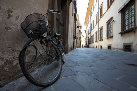 small town life: Street scene from a town in Europe, bicycle in the foreground Stock Photo