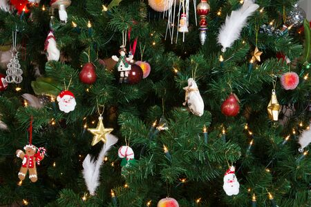 a close up: close up of a decorated christmas tree with glowing lights Stock Photo