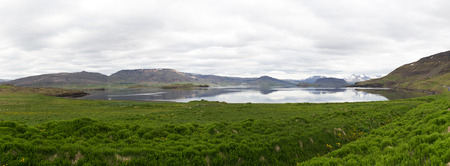 south western: Panoramic shot of Hvalfjordur in south western Iceland, shot during summer on a overcast day