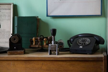 old furniture: Shot of items on a wooden desk, old telephone and vintage items Stock Photo