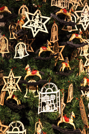 trees seasonal: Cropped shot of wooden christmas decorations on a tree Stock Photo