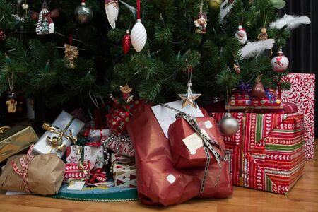 christmas spirit: close up shot of christmas presents under a christmas tree