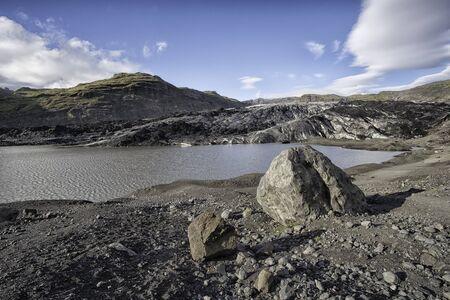Solheimajokull outlet glacier in Iceland, photo taken in summer during a rather hot day in sunshine