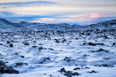 Icelandic lava field covered with snow shot at dusk in winter