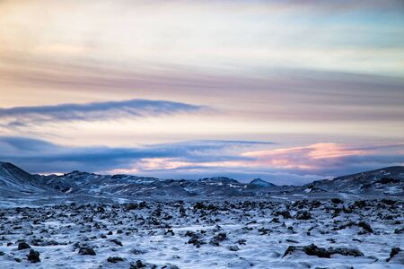 Icelandic lava field covered with snow, shot at dusk with dramatic skies in winter