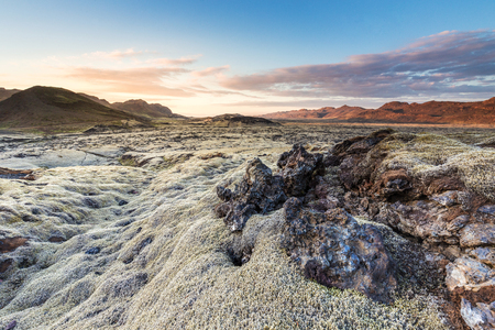 Lava field in the Reykjanes peninsula of southern iceland, shot as the sun was setting behind some mountains