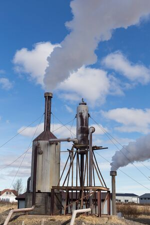 Geothermal powerplant on a farm in rural Iceland,great as a concept image for clean green energy
