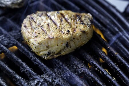 A slice of pork on the barbecue, just about ready Stock Photo