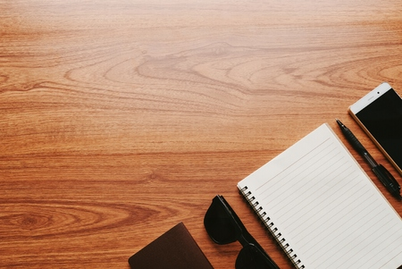 Blank notebook on wood table with men's accessories. Standard-Bild