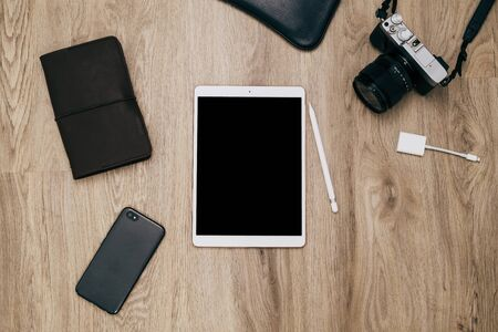 Top view of tablet computer and accessories,Travel vacation background concept.