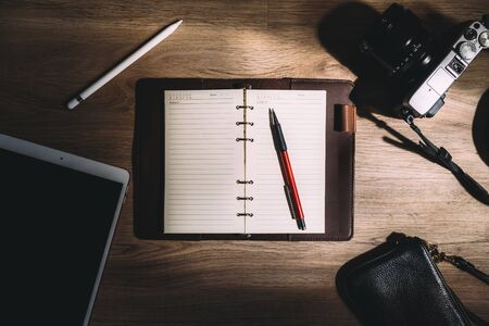 Top view of notebook ,camera ,smart phone and accessories,Travel vacation background concept. Banque d'images - 133534077
