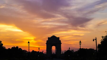 india gate: Silhouette of India Gate against amazingly beautiful sunset and sky