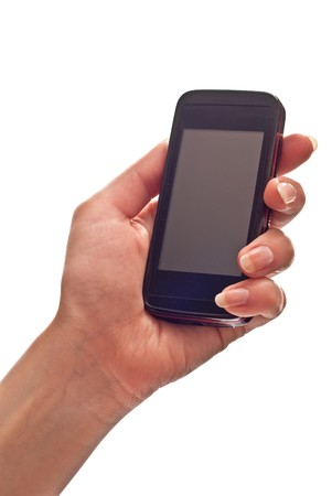 Mobile phone in womans hand. Isolated on white