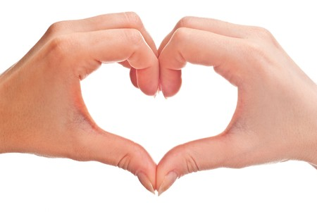 shaped: heart shape made of two womans hands. Isolated on white Stock Photo