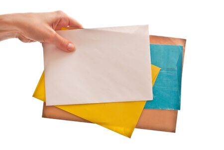 Many envelopes with letters in hand. Isolated on white photo