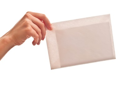 White envelope in woman's hand. Isolated on white Stock Photo - 7411753
