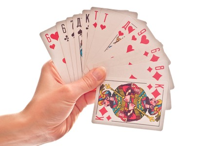 achievement cards: Game cards in womans hand. Isolated on white