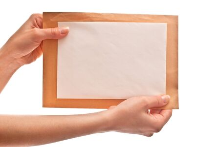 Two envelopes in woman's hands. Isolated on white background Stock Photo - 7412044