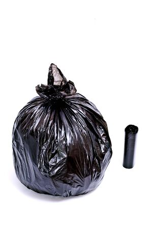 Black garbage bag isolated on white photo