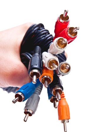 input: RCA plug connectors in man hand isolated on white background