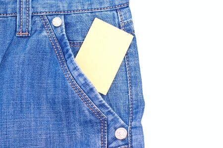 Yellow message paper iin jeans pocket isolated on white photo