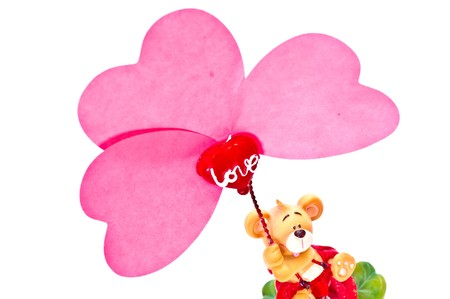 small toy hold in hande pink paper heart. Isolated on white photo