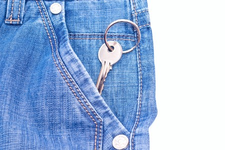 One key from house in jeans pocket. Isolated on white Stock Photo - 7374882