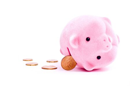 inclined pink pig with coins isolated on white Stock Photo