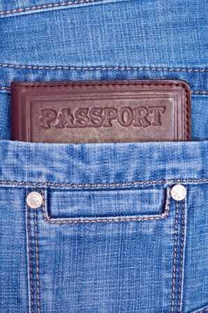 Brown passport in back jeans pocket photo