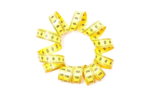yellow tape measure isolated on white background photo