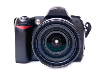 Black camera equipped with zoom lens isolated on white background Stock Photo - 7372972