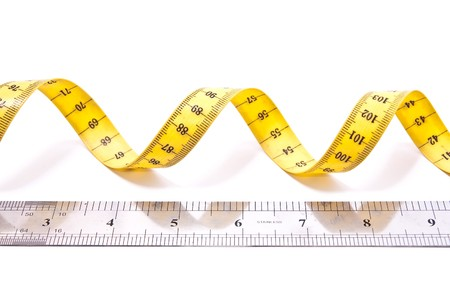 depth measurement: Rolled yellow centimeter isolated on white background