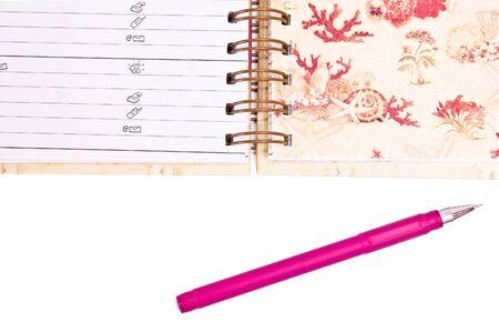 handbook: Handbook with pink pen isolated on white Stock Photo