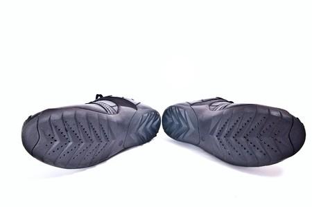 Black sole of shoes isolated on white background. Horizontal shot photo
