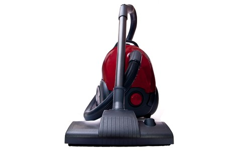 Modern vacuum cleaner isolated on white background photo