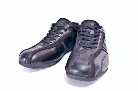 Black  shoes isolated on white background. Horizontal shot photo