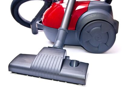 One red vacuum cleaner isolated on white background photo