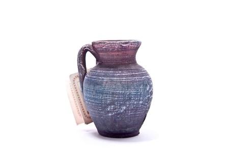 Souvenir old vase isolated on white background photo