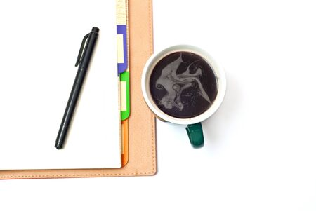 Coffee, opened notebook and pen isolated on white photo