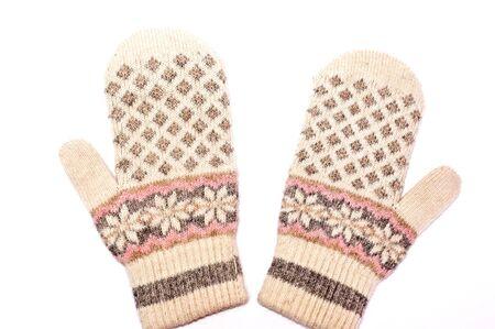 the mittens: Dos mitones de invierno aislados en blanco  Foto de archivo