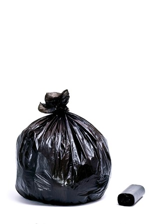 Black garbage bags isolated on white photo