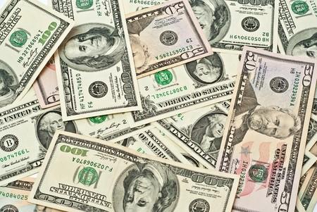 hundred dollar bill: A scattered pile of hundred, one, fifty, twenty dollar bills.